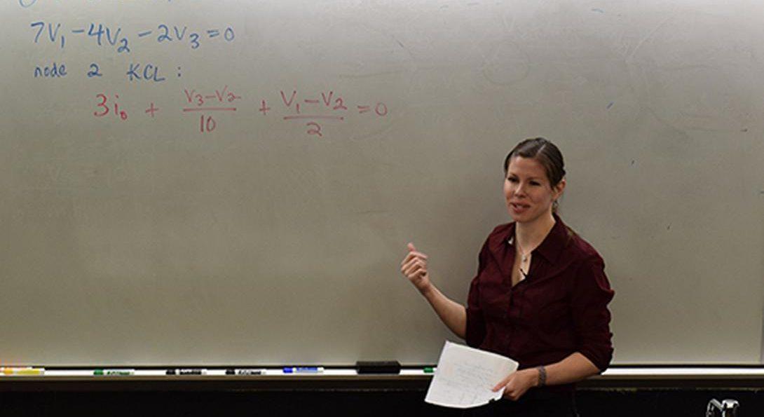 professor at white board