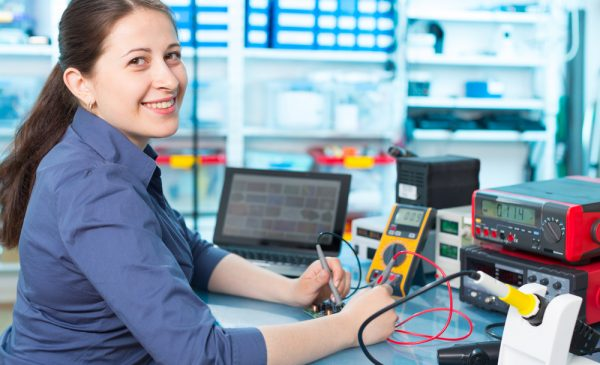 student with electrical testing equipment