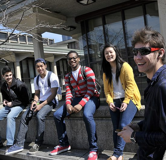 UIC students in a group on the quad
