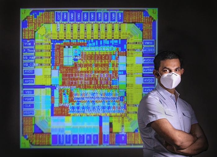 Assistant Professor Amit Trivedi, shown with a detailed image of a computer chip