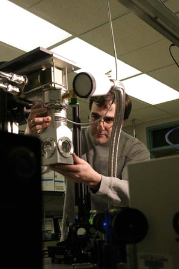Dimitri Alexson works with equipment in the NanoEngineering Research Lab, where Dr. Michael Stroscio will conduct research on liquid condensates in cells