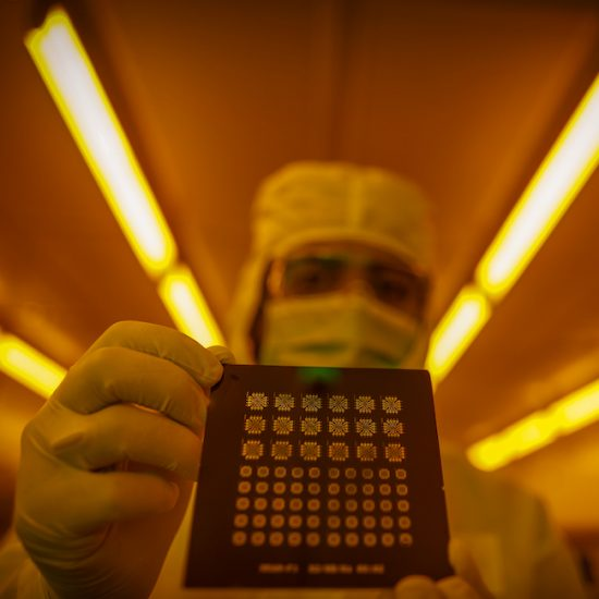 a research scientist holds a nanotechnology device in UIC's Nanotechnology Core Facility